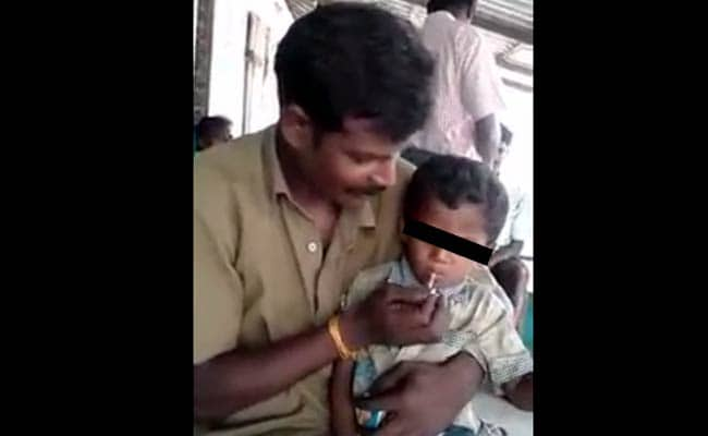 5 year old boy smoking beedi